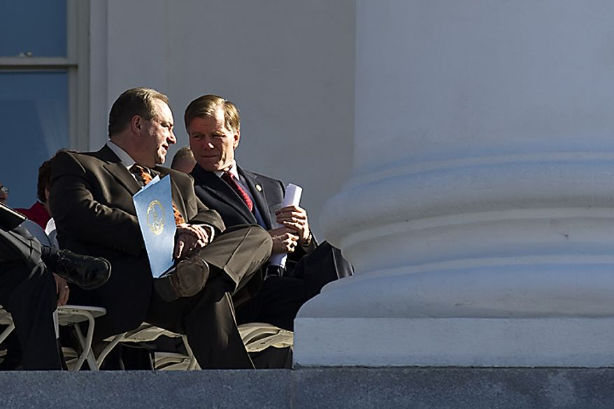 Lt. Gov. Bill Bolling, R-Va. left, talks with Gov. Bob McDonnell, R-Va., on the Statehouse steps during a Virginia Call to Prayer Day event, in Richmond, Va., Wednesday, April 6, 2011. (Drew Angerer/The Washington Times)