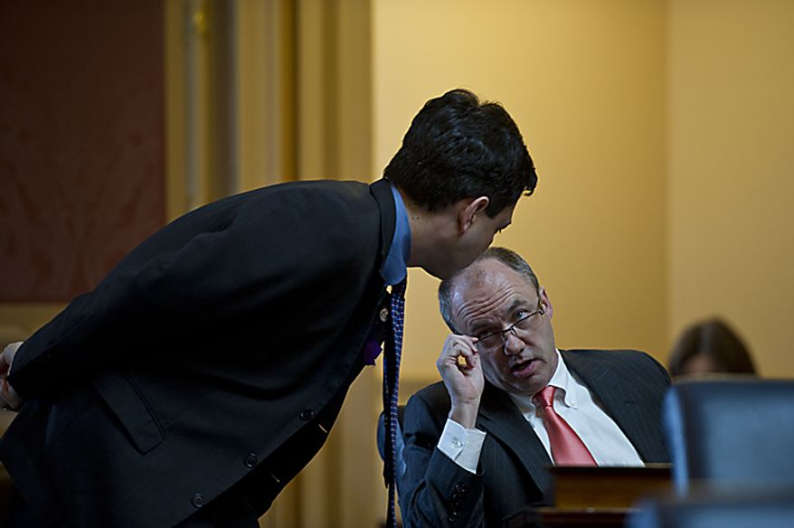 Democratic House Minority Leader Ward Armstrong, right, speaks with Del. Scott Surovell, D-Fairfax, during debate on a state redistricting plan during a House session at the Capitol, in Richmond, Va., Tuesday, April 5, 2011. The House passed the Republican sponsored plan. (Drew Angerer/The Washington Times)