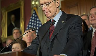 Senate Majority Leader Harry Reid (D-NV) is joined by approximately half of the democratic as they hold a press conference following the democratic caucus at the Capitol in Washington, D.C., Friday, April 8, 2011. (Rod Lamkey Jr/The Washington Times)