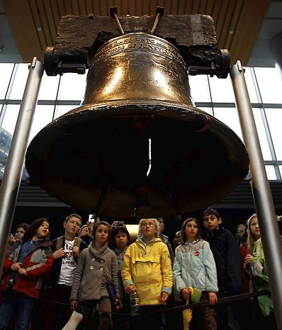 Visitors to Independence National Historical Park view the Liberty Bell Friday, April 8, 2011, in Philadelphia as negotiations continue in Washington to avoid a government shutdown, which would close national parks and many other federal services. (AP Photo/Matt Rourke)