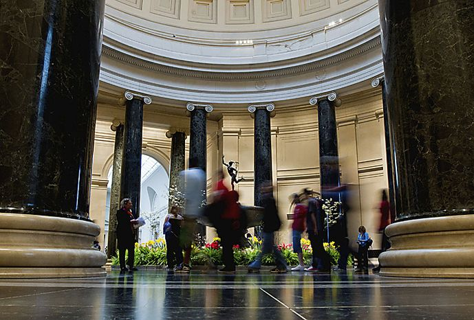 Patrons walk through the National Gallery of Art in Washington, Friday, April 8, 2011, as Congress continues to debate in hopes of avoiding a government shutdown. (AP Photo/Alex Brandon)