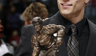 Miami of Ohio senior forward Andy Miele smiles after winning the Hobey Baker Memorial Award for the top NCAA hockey player in a ceremony in St. Paul, Minn. Friday April 8, 2011.(AP Photo/Andy King)