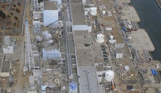** FILE ** In this March 20, 2011, aerial file photo taken by a small unmanned drone and released by AIR PHOTO SERVICE, the crippled Fukushima Dai-ichi nuclear power plant is seen in Okumamachi, Fukushima prefecture, northeastern Japan. From top to bottom: Unit 1, Unit 2, Unit 3 and Unit 4. (AP Photo/AIR PHOTO SERVICE, File)