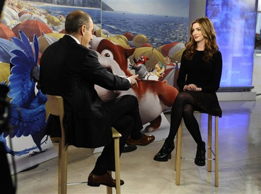 """In this publicity image released by NBC, co-host Matt Lauer, left, talks with actress Anne Hathaway as she appears on the """"Today"""" show to talk about her role in the animated film, """"Rio"""" Thursday, April 7, 2011 in New York. (AP Photo/NBC,  Peter Kramer)"""