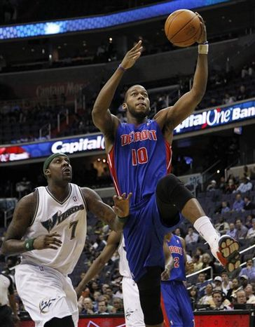 Detroit Pistons' Greg Monroe (10) shoots a lay up against Washington Wizards' Andray Blatche (7) during the first half of an NBA basketball game in Washington, Tuesday, April 5, 2011.  (AP Photo/Manuel Balce Ceneta)