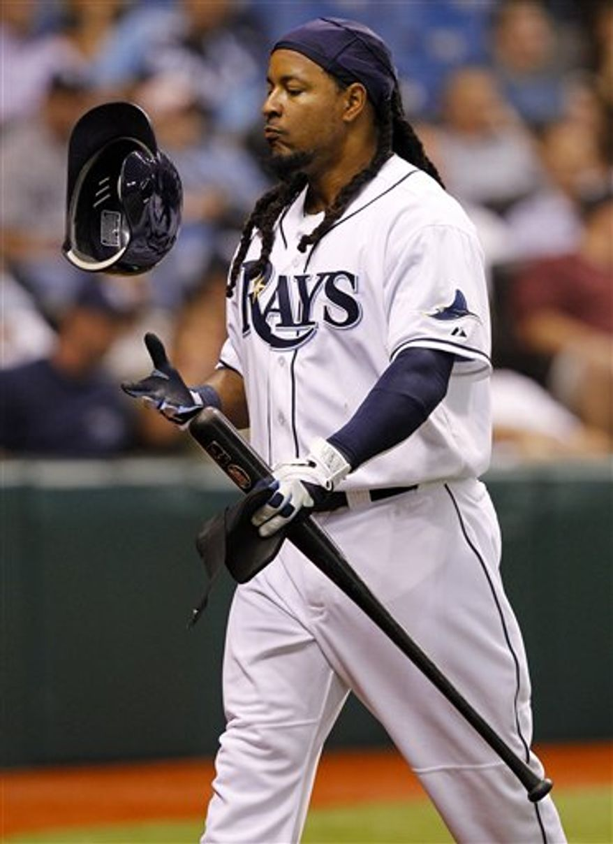 FILE - In tis April 5, 2011 file photo, Tampa Bay Rays' Manny Ramirez reacts after striking out in the fourth inning of a baseball game against the Los Angeles Angels in St. Petersburg, Fla. Ramirez has notified Major League Baseball that he is retiring after being notified of an issue under MLB's drug policy.  The commissioner's office issued a statement Friday, APril 8, 2011, that said Ramirez decided to retire rather than go through MLB's Joint Drug Prevention and Treatment Program. (AP Photo/Mike Carlson, File)