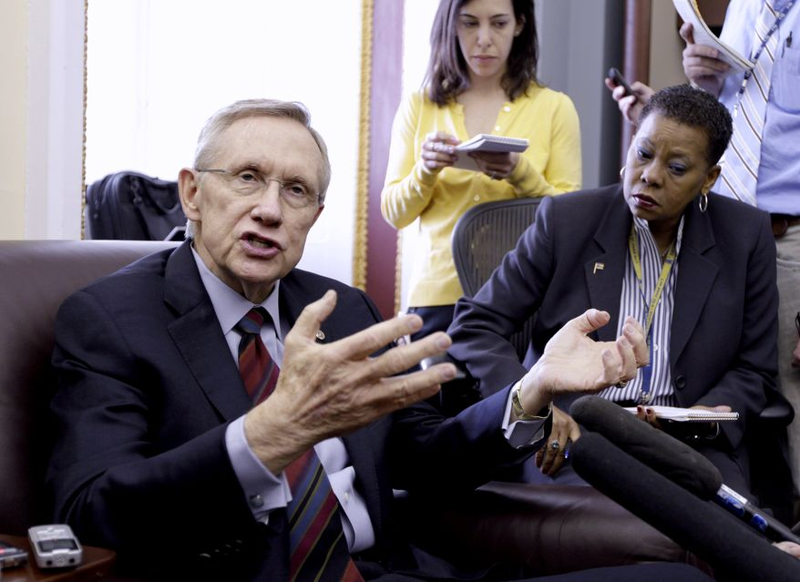 Senate Majority Leader Harry Reid of Nev., gestures while speaking with reporters on Capitol Hill in Washington, Friday, April 8, 2011, to discuss the budget impasse. (AP Photo/J. Scott Applewhite)