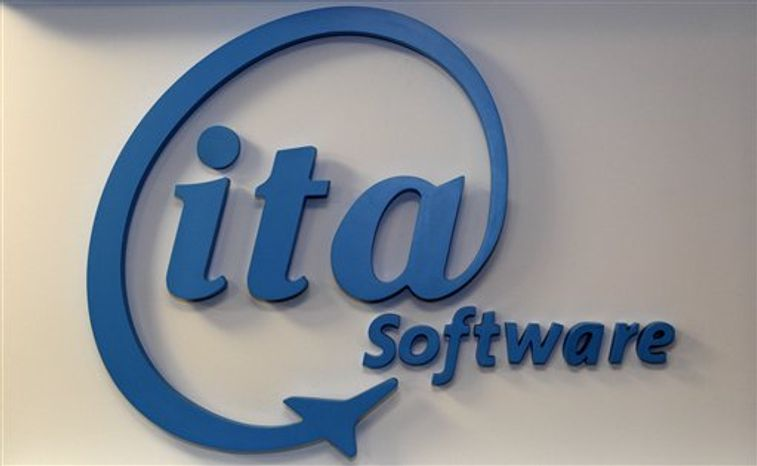 In this Feb. 9, 2011 photo, the logo of ITA Software is displayed at the company's office in Cambridge, Mass. Government officials are letting Google proceed with its $700 million purchase of airline fare tracker ITA Software. The deal will establish the Internet search giant as a key player in the online travel market.(AP Photo/Charles Krupa)