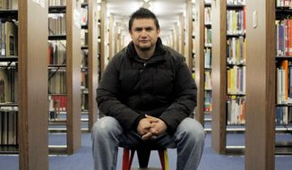 Fernando Molina left Mexico for the U.S. more than a decade ago and settled in Aurora, Ill. He is part of a migratiton to the suburbs offering established Hispanic neighborhoods that include homes, stores and libraries. (Associated Press)