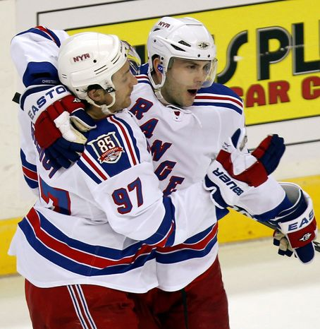 ASSOCIATED PRESS Caps players say they're a different team than they were when they had two blowout losses against Erik Christensen (right), Matt Gilroy (97) and the rest of the New York Rangers this season. The two teams square off in the first round of the playoffs. The Caps are the top seed in the Eastern Conference.