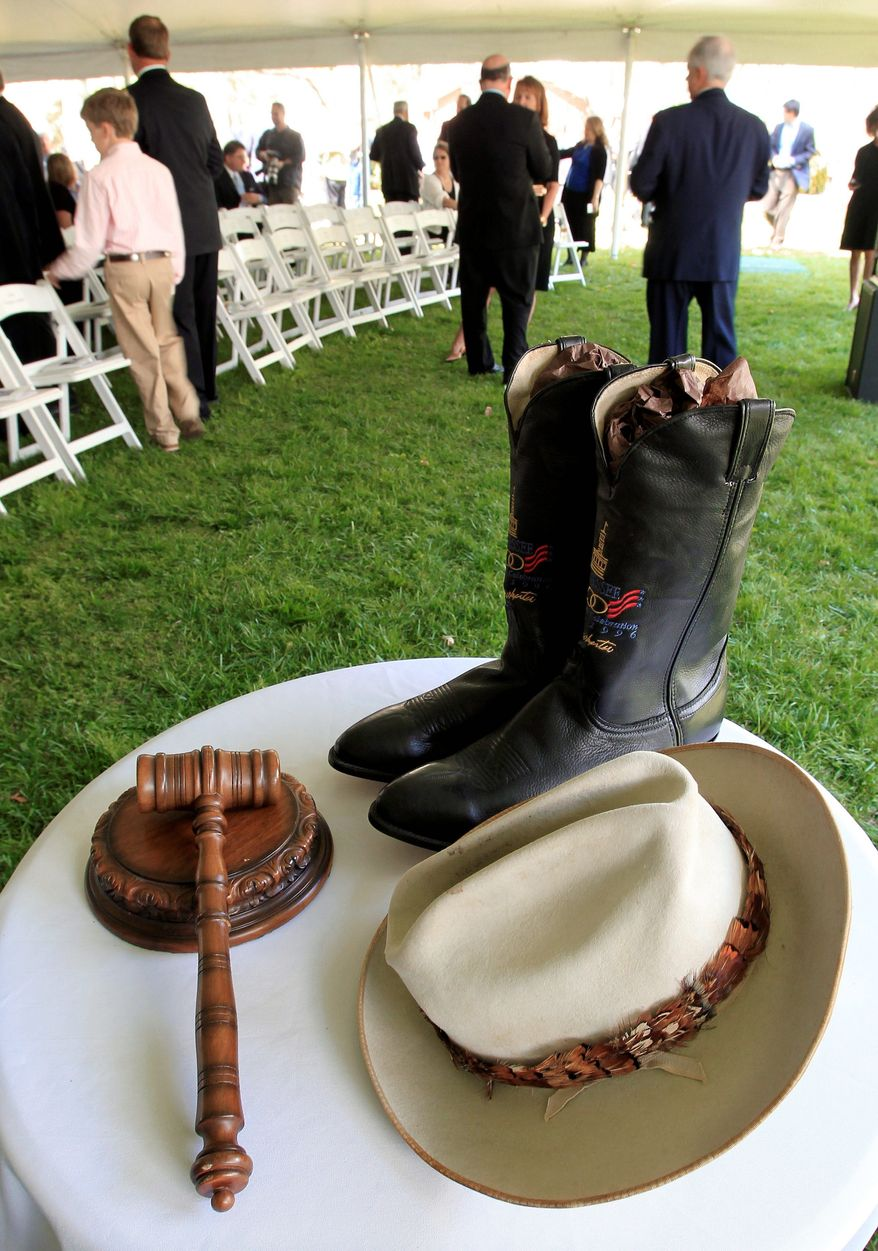 A hat, gavel and boots belonging to former Tennessee Gov. Ned McWherter are displayed before a memorial service Sunday at his home in Dresden, Tenn. Mr. McWherter, a two-term Democratic governor, died April 4. (Associated Press)