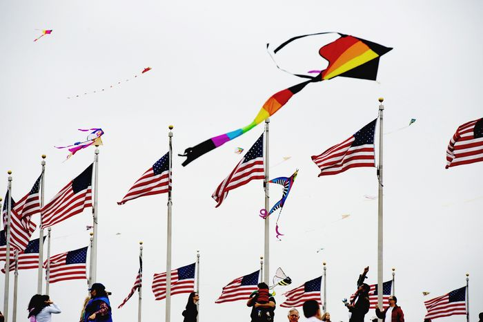 Kites soar high above the flags at the base of the Washington Monument during the annual kite festival on the Mall. After 44 years of Smithsonian Institution sponsorship, this was the first year the kite festival was an event sponsored by the National Cherry Blossom Festival, which began March 26 and ended Sunday. (Drew Angerer/The Washington Times)