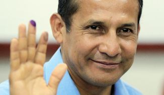 ASSOCIATED PRESS Presidential candidate Ollanta Humala, a former military officer, waves after casting his ballot in the general elections in Lima, Peru, on Sunday.