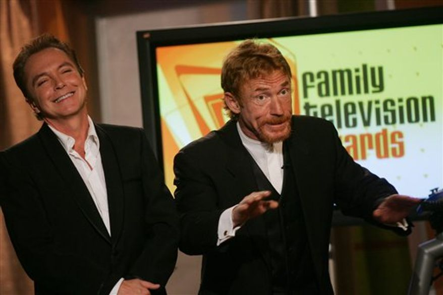 """FILE - In a Dec. 1 2004 file photo, David Cassidy, left, and Danny Bonaduce, who played brothers on """"The Partridge Family,"""" joke on stage before presenting the award at the annual Family Television Awards in Beverly Hills, Calif. Cassidy and Bonaduce played on a song onstage together at the Resorts Casino Hotel in Atlatic City Saturday, April 9, 2011. They say it was only the second time in 40 years they've done so. (AP Photo/Danny Moloshok, File)"""