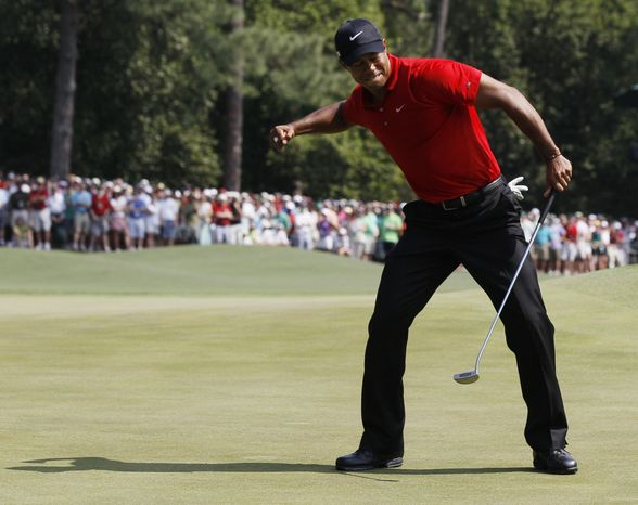 Tiger Woods reacts after an eagle putt on the eighth hole during the final round of the Masters golf tournament Sunday, April 10, 2011, in Augusta, Ga. (AP Photo/David J. Phillip)