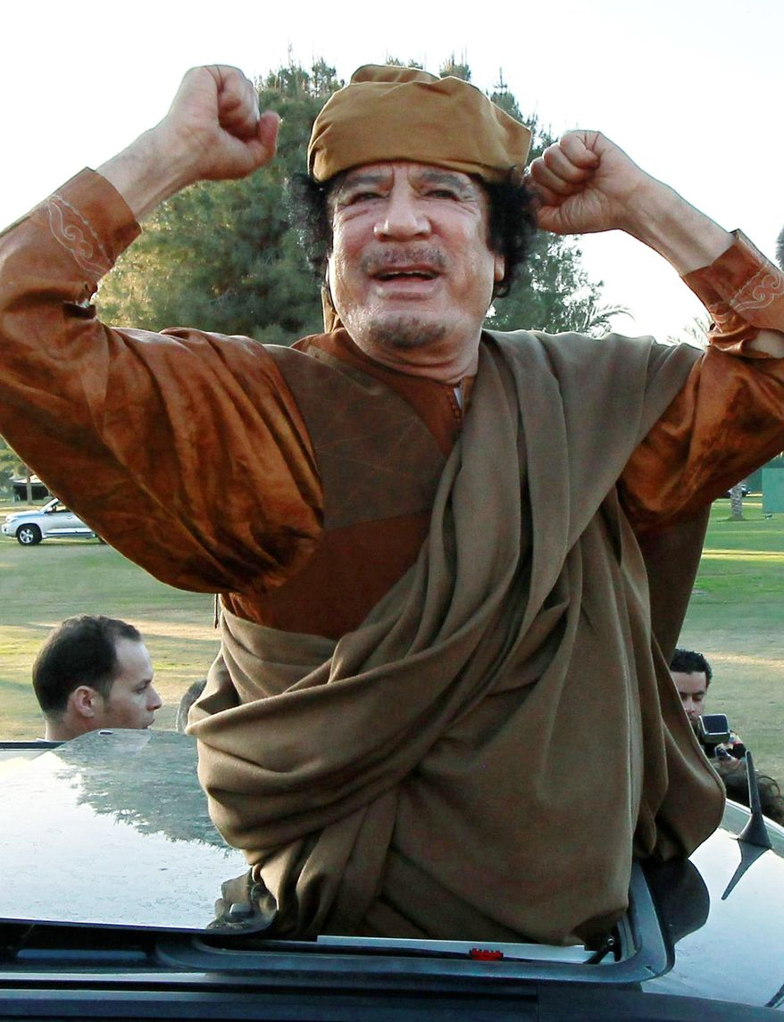 Libyan leader Col. Moammar Gadhafi greets supporters in Tripoli on Sunday as envoys from the African Union, including South African President Jacob Zuma, arrived for two days of talks with Col. Gadhafi and rebel leaders. The African Union repeated its call for a cease-fire. (Associated Press)