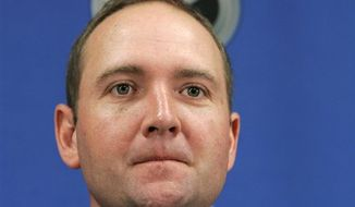 FILE - In this June 16, 2008, file photo, Peter DeBoer talks to the media in Sunrise, Fla., after he was named the new coach of the Florida Panthers NHL team. The Panthers fired DeBoer on Sunday, April 10, 2011, one day after the team finished its 10th straight season without a playoff appearance. (AP Photo/J. Pat Carter, File)