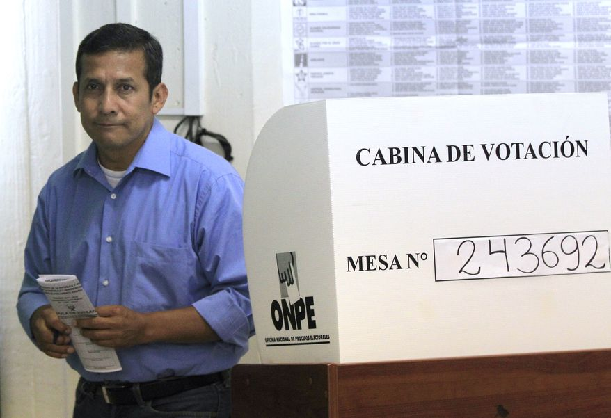 Presidential candidate Ollanta Humala, a former military officer, votes in general elections in Lima, Peru, on Sunday, April 10, 2011. Mr. Humala, who promises to favor the poor by redistributing Peru's mineral wealth, was expected to win the most votes in Sunday's presidential elections but fall far short of the outright majority needed to avoid a runoff. (AP Photo/Martin Mejia)