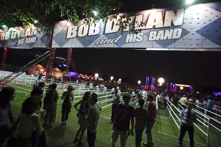 "Vietnamese and foreign audiences come to the concert named ""Bob Dylan - Live in Vietnam,"" a one night only show held at RMIT University in Ho Chi Minh City, Vietnam on Sunday, April 10, 2011.  After nearly five decades of singing about a war that continues to haunt a generation of Americans, legendary performer Bob Dylan is finally getting his chance to see Vietnam at peace. (AP Photo/Le Quang Nhat)"