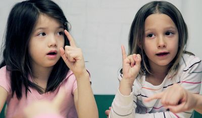 First-grade students learn sign language at the Blue School, which allows children to play a role in choosing their curriculum. (Associated Press)