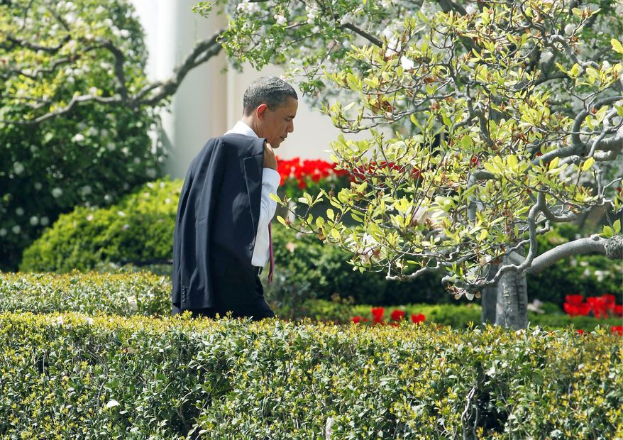 President Obama walks back toward the Rose Garden of the White House on Monday after meeting students from Altona Middle School in Longmont, Colo. The president received a letter from a school parent who was worried that her son's trip would be canceled by a government shutdown, which was averted. (Associated Press)