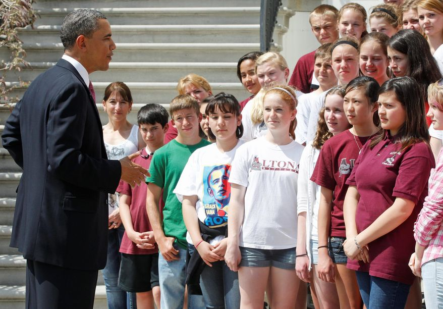 President Obama greets students from Altona Middle School in Longmont, Colo., on the South Portico of the White House on Monday. Shalini Schane (second from left) had written to the president. (Associated Press)