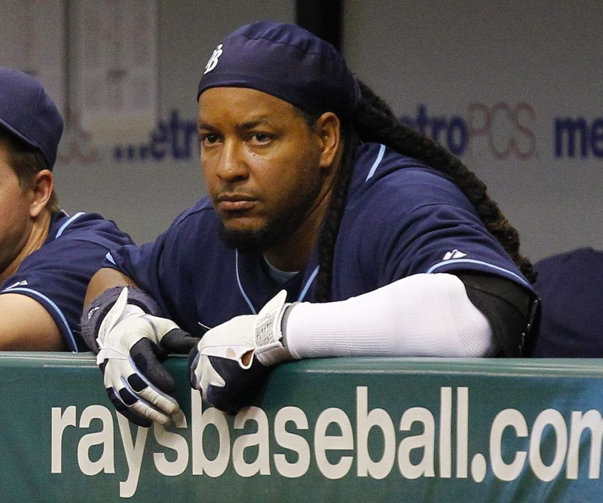 In this photo taken April 6, 2011, Tampa Bay Rays' Manny Ramirez watches from the dugout during a baseball game against the Los Angeles Angels in St. Petersburg, Fla. Ramirez has notified Major League Baseball that he is retiring after being notified of an issue under MLB's drug policy. The commissioner's office issued a statement Friday, APril 8, 2011, that said Ramirez decided to retire rather than go through MLB's Joint Drug Prevention and Treatment Program. (AP Photo/Mike Carlson)