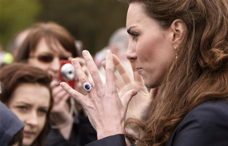 **FILE** Kate Middleton reacts to the crowd at Witton County Park, Darwen, England, on April, 11, 2011. (Associated Press)