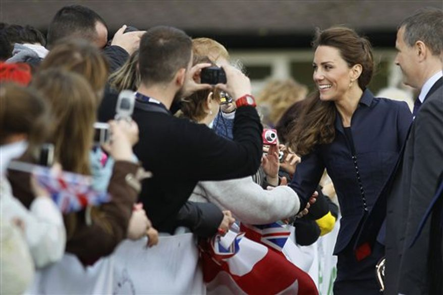 Kate Middleton reacts to the crowd, during a visit to Witton County Park, Darwen, near Blackburn, England Monday, April, 11, 2011. Middleton is to wed Britain's Prince William at Westminster Abbey on April 29. (AP Photo/Alastair Grant, Pool)