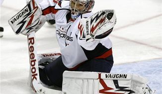 Washington Capitals goalie Michal Neuvirth (30) watches as Florida Panthers right wing Bill Thomas puck scores a goal in the third period of an NHL hockey game in Sunrise, Fla., Saturday, April 9, 2011. The Panthers won 1-0. (AP Photo/Alan Diaz)