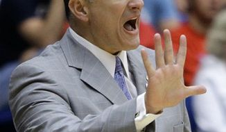 FILE - This March 19, 2011, file photo shows Kansas State head coach Frank Martin directing his team against Wisconsin during a Southeast Regional NCAA college basketball tournament game, in Tucson, Ariz.  Martin says he's never been contacted by Miami about the Hurricanes' head coaching job and he has no plans to leave Kansas State.  But the 2010 Big 12 coach of the year says he has been approached by several other schools in the past two years and offered significant pay increases. (AP Photo/Matt York, File)