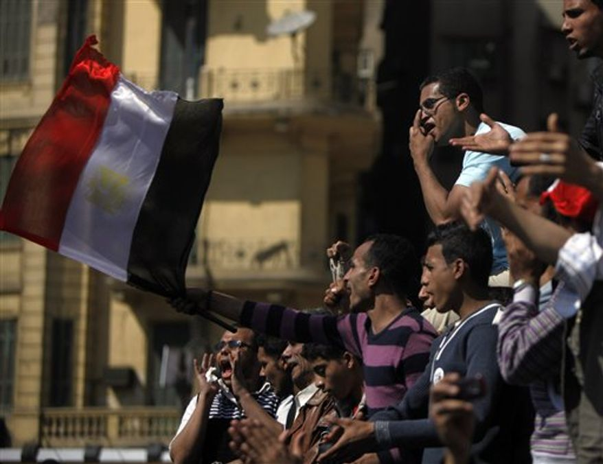 Egyptians shout anti- Mubarak slogans during their protest at Tahrir Square in Cairo, Egypt, Sunday, April 10, 2011. In the first remarks since his ouster, former Egyptian President Hosni Mubarak denied he abused his authority to amass wealth and property in a pre-recorded speech broadcast Sunday. (AP Photo/Amr Nabil)