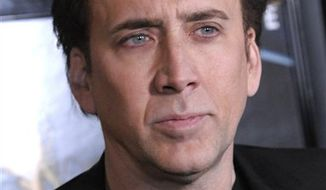 """FILE - In this Feb. 22, 2011 file photo, actor Nicolas Cage arrives at the premiere of the feature film """"Drive Angry"""" in Los Angeles. (AP Photo/Dan Steinberg, file)"""