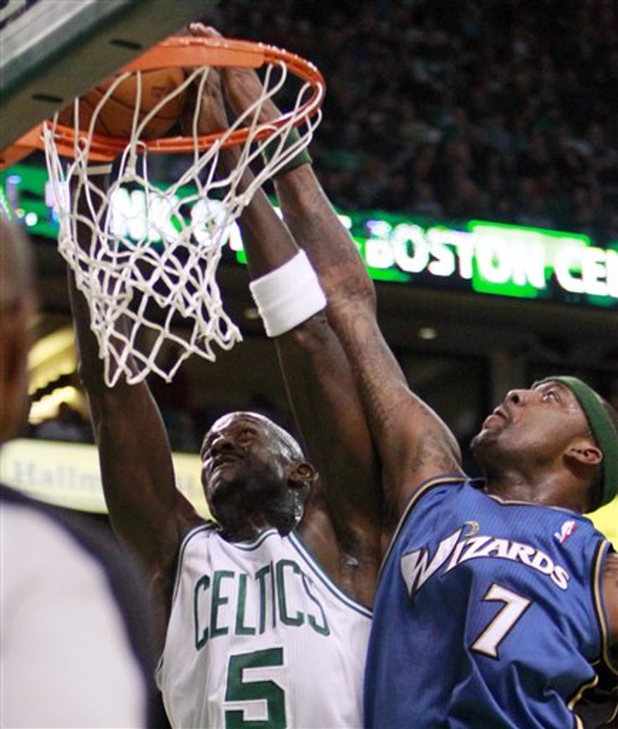 Boston Celtics' Ray Allen, left, lays up a shot in front of Washington Wizards' Andray Blatche in the first quarter of an NBA basketball game on Friday, April 8, 2011, in Boston. The Celtics won 104-88. (AP Photo/Michael Dwyer)