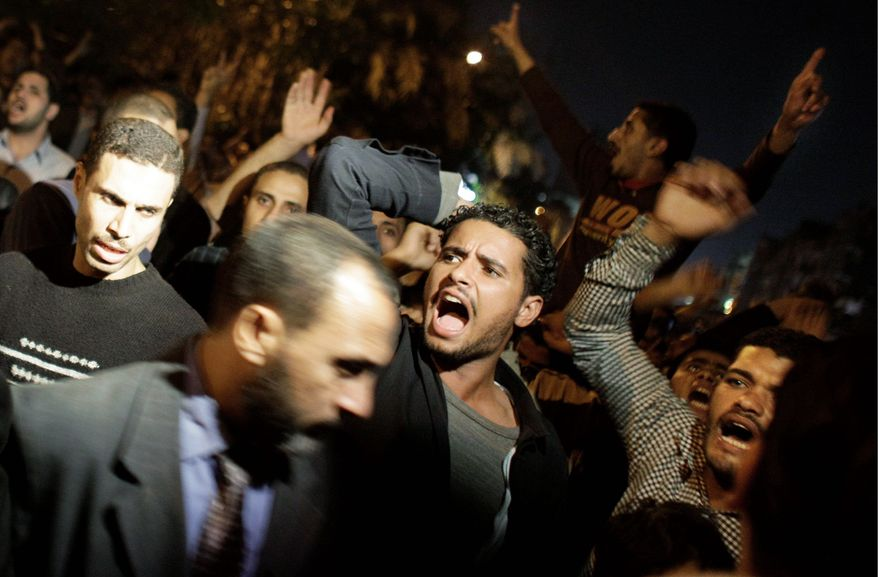 Muslim Brotherhood supporters alleging electoral fraud chant during a standoff with riot police outside a vote-counting center in Cairo in November. The Brotherhood has years of experience in contesting elections, giving it a leg up in post-Mubarak Egyptian politics. (Associated Press)