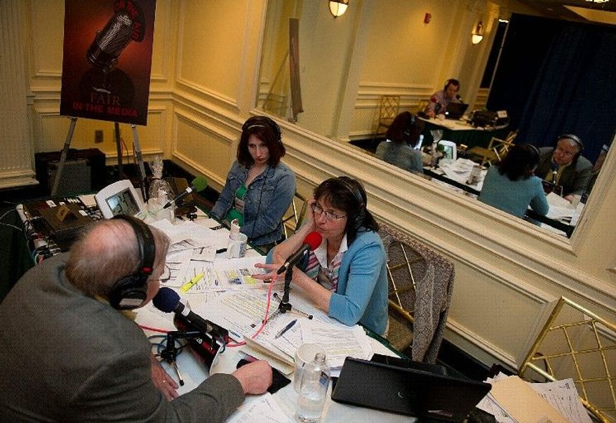 "Helen Glover (right), host of the ""Helen Glover Show"" on WHJJ-AM in Providence, R.I., talks with Peter Gadiel, director of 911 Families for A Secure America, on the air during a broadcast on April 6 from the Phoenix Park Hotel as her executive producer Dee DeQuattro looks on. The broadcast was part of a national drive for immigration reform called ""Hold Their Feet to the Fire."" About 50 radio talk-show hosts participated. (Barbara L. Salisbury/The Washington Times)"