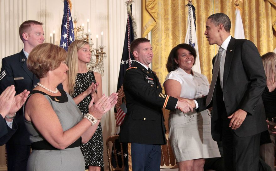 """President Obama greets members of the military and their families at the White House on Tuesday after first lady Michelle Obama announced """"Joining Forces,"""" which is intended to help troops and their loved ones on multiple fronts. (Associated Press)"""