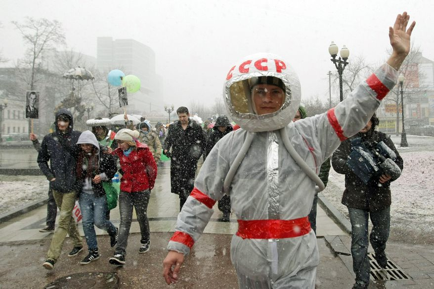 A flashmob rally in Moscow marks the 50th anniversary of cosmonaut Yuri Gagarin's first human spaceflight, a feat that remains a source of national pride. (Associated Press)