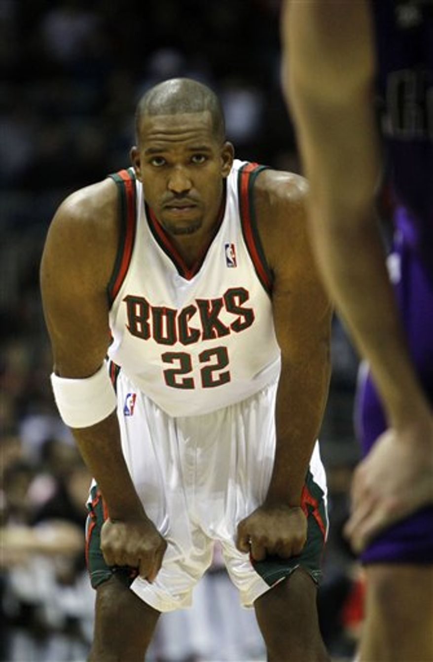 FILE - In this Dec. 19, 2009 file photo, Milwaukee Bucks' Michael Redd looks on during the first half of an NBA basketball game against the Sacramento Kings in Milwaukee. Redd's 11-year journey with the Bucks likely comes to an end in Wednesday night's season finale at Oklahoma City. Coming off two major knee injuries, he is in the final year of a six-year, $91 million contract and is unlikely to be re-signed. (AP Photo/Morry Gash)