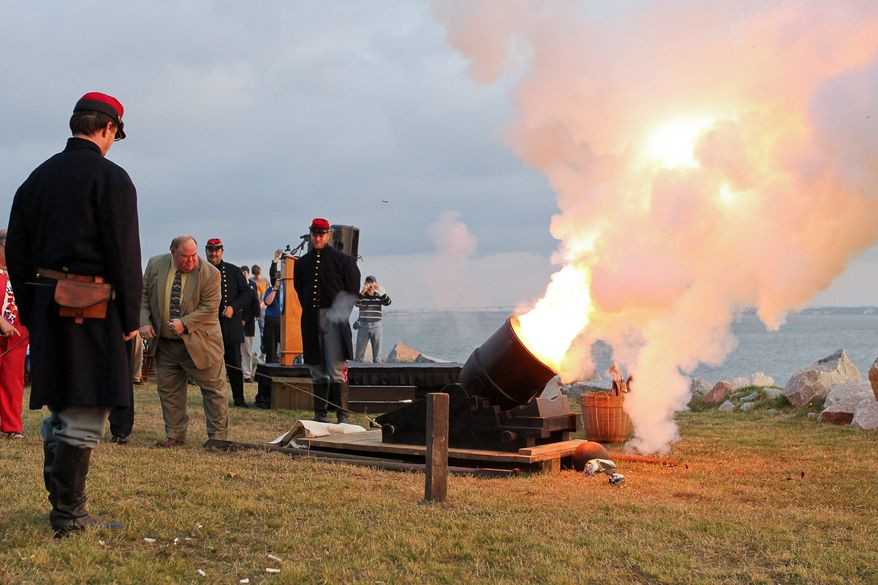 William Farley (second from left) fires a mortar at Fort Johnson, near Fort Sumter, in Charleston, S.C., on Tuesday, April 12, 2011, to commemorate the moment the first shots of the Civil War were fired 150 years ago. (AP Photo/Alice Keeney)