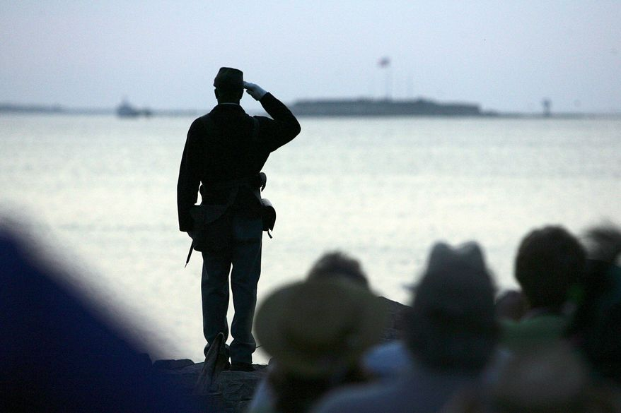 Ernest Parks, a re-enactor from Company I, Massachusetts 54th Regiment, salutes after tossing a wreath into Charleston Harbor toward Fort Sumter (in background) on Tuesday, April 12, 2011, during the commemoration of the 150th anniversary of the start of the Civil War. (AP Photo/Post and Courier, Wade Spees)