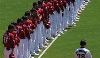 Players of the Rakuten Golden Eagles, a Japanese professional team based in Sendai, northeastern Japan, observe a moment of silence for victims of the March 11 earthquake and tsunami before their baseball game against the Lotte Marines in Chiba, near Tokyo, on Tuesday, April 12, 2011. The 2011 pro baseball regular season kicked off on Tuesday in Japan. (AP Photo/Itsuo Inouye)