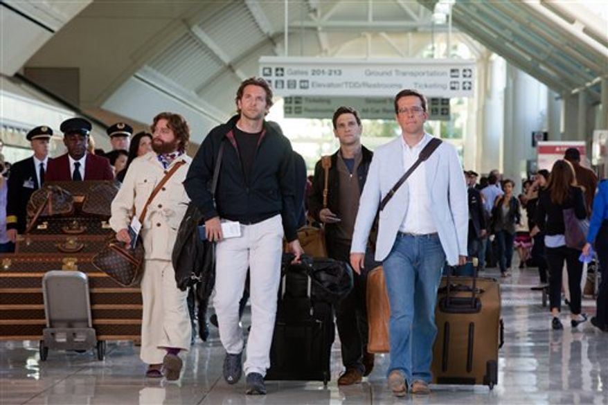 """In this film publicity image released by Warner Bros. Pictures, from left, Zach Galifianakis, Bradley Cooper, Justin Bartha and Ed Helms are shown in a scene from, """"The Hangover: Part II."""" (AP Photo/Warner Bros. Pictures, Melinda Sue Gordon)"""