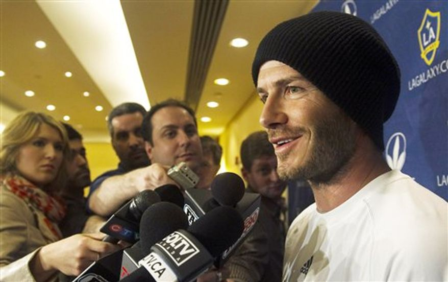 Los Angeles Galaxy soccer player David Beckham speaks to the media during a news conference in Toronto on Tuesday, April 12, 2011. The Galaxy taken on Toronto FC in an MLS soccer match on Wednesday. (AP Photo/The Canadian Press, Nathan Denette)