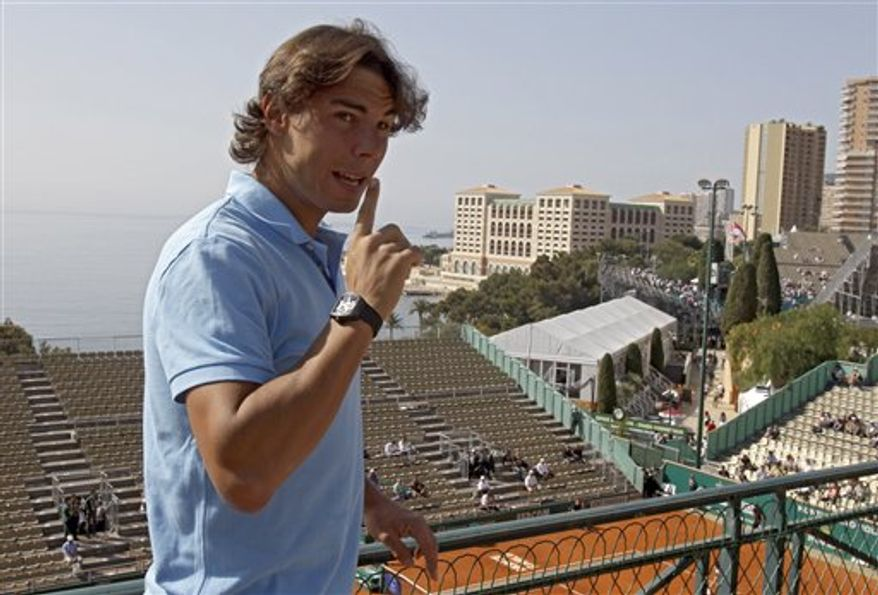 Spanish player Rafael Nadal poses after his press conference at the Monte Carlo Tennis Masters tournament in Monaco, Monday, April 11 , 2011.  The Monte Carlo Masters  ATP clay court event  at the Monte Carlo Country Club began on Monday,(AP Photo/Lionel Cironneau)