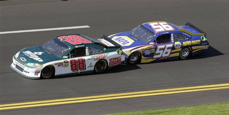 FILE - In this Feb. 20, 2011, file photo, Dale Earnhardt Jr. (88) and Martin Truex Jr. (56) team up during the Daytona 500 NASCAR auto race at Daytona International Speedway in Daytona Beach, Fla. Two-car tandems took over the season-opening Daytona 500, where the huge pack of cars broke apart as drivers realized that the fastest way around the superspeedway was with just one partner. Two drivers hooked up, took turns pushing each other to the front, then swapped the lead when their engines got too hot from all that pushing. Many fans fear a repeat of that racing at Talladega, and by every indication, that's exactly what they'll see. (AP Photo/Lynne Sladky, File)