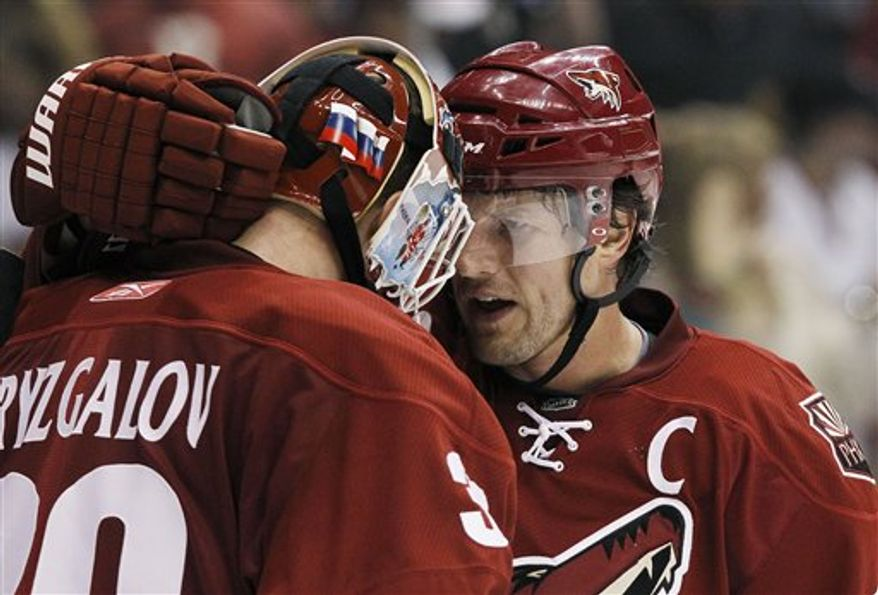 Phoenix Coyotes' Ilya Bryzgalov (30), of Russia, makes a save on a shot by San Jose Sharks' Logan Couture (39) during the third period of an NHL hockey game Friday, April 8, 2011, in Glendale, Ariz.  The Coyotes defeated the Sharks 4-3. (AP Photo/Ross D. Franklin)