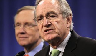 """**FILE** Sen. Tom Harkin (foreground), Iowa Democrat, joins Senate Majority Leader Harry Reid, Nevada Democrat, and other senators at a """"Back Off Social Security"""" rally on Capitol Hill in Washington on March 28, 2011. (Associated Press)"""