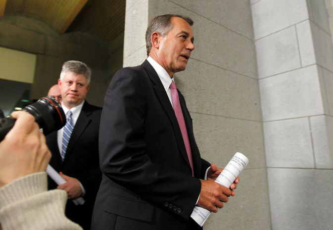 House Speaker John A. Boehner heads for a Republican caucus meeting on Friday. The budget pact worked out last week calls for $513 billion for defense, a cut of $18.1 billion from the president's proposal but more than $5 billion more than last year's amount. (Associated Press)
