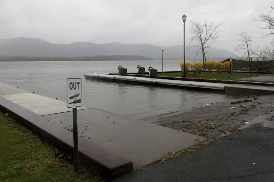 A woman drove a minivan carrying three of her four children down this boat ramp into the Hudson River in Newburgh, N.Y., on Wednesday, April 13, 2011. All the occupants of the minivan, which was found in 10 feet of water about 25 yards offshore, died, the city fire chief said. (AP Photo/Seth Wenig)
